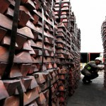 A port worker checks a shipment of copper that is to be exported to Asia in Valparaiso port, Chile